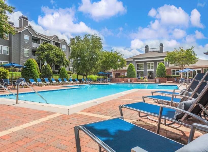 View of Pool Area, Showing Picnic Areas, Loungers, and Pergola at Waterford Creek Apartments